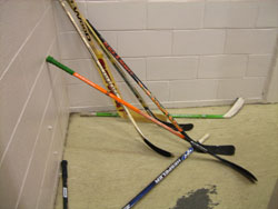 Disorganized mess of hockey sticks - a safety risk to players, coaches, volunteers, and officials